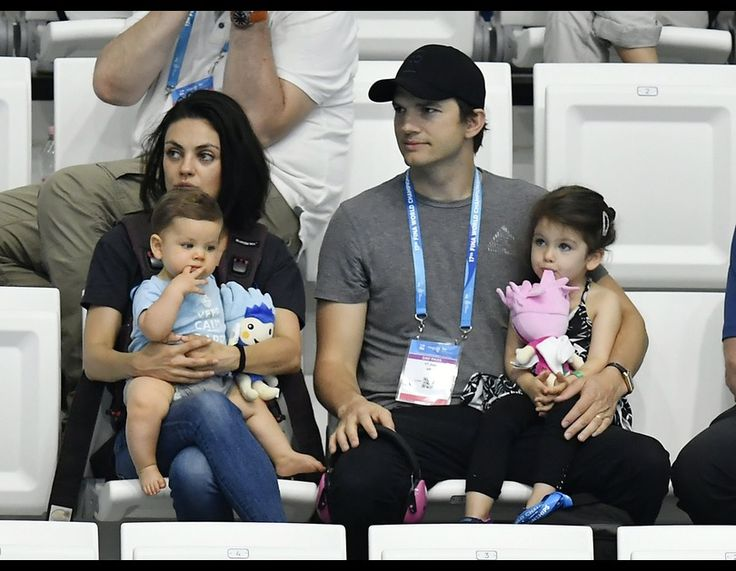 Mila Kunis and Ashton Kutcher are seen with their children Dimitri and Wyatt at the women's 3m synchro springboard final of the 17th FINA Swimming World Championships in Duna Arena in Budapest, Hungary, Monday, July 17, 2017.  CREDIT: ASSOCIATED PRESS