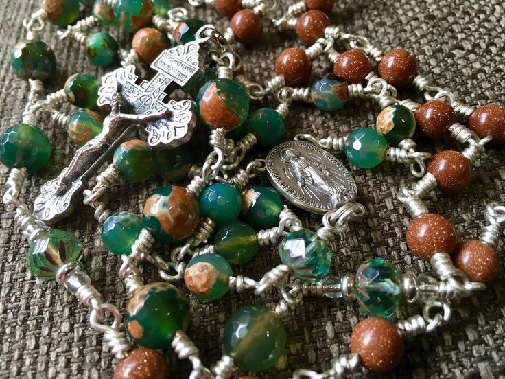 """Excited to share the latest addition to my #etsy shop: Hand wire wrapped orange green Excited to share the latest addition to my #etsy shop: Hand wire wrapped orange green grade A facted Agates and goldstone with Bohemian Czech glass beads for the """"Our Father """" http://etsy.me/2j2SdEO grade A facted Agates and goldstone with Bohemian Czech glass beads for the """"Our Father """""""