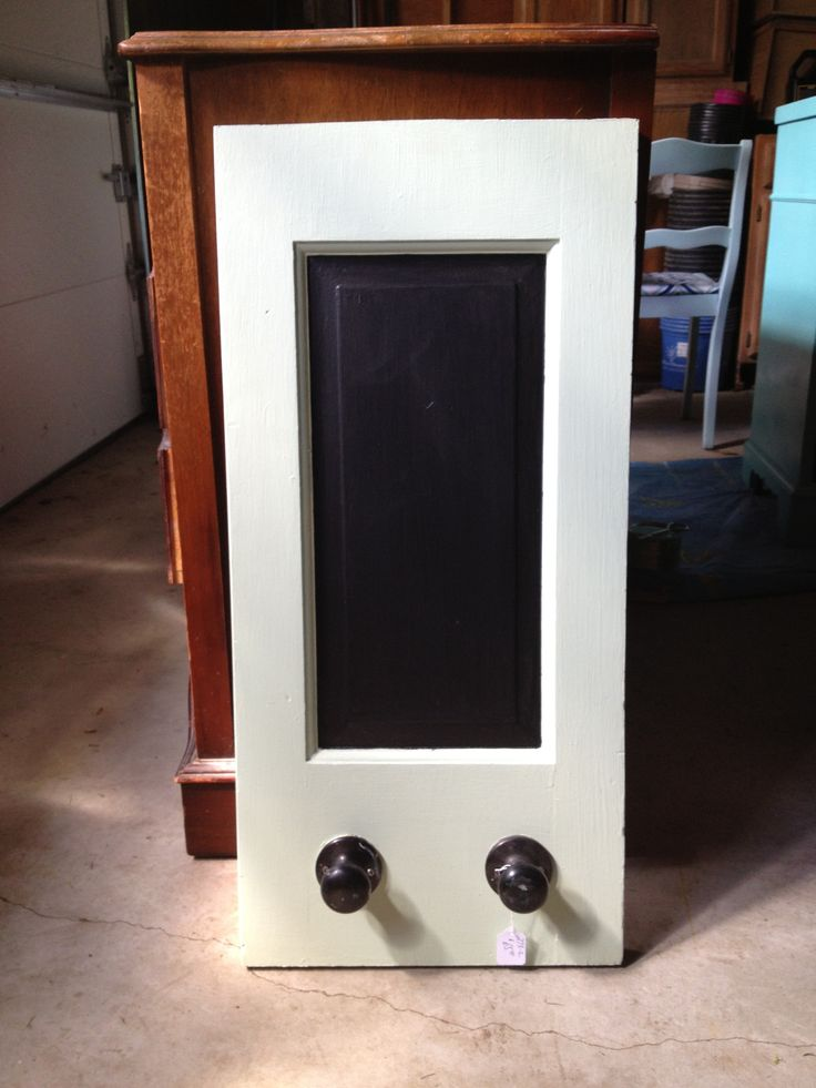 Old door cut in half and knobs used as hangers. Chalkboard ...