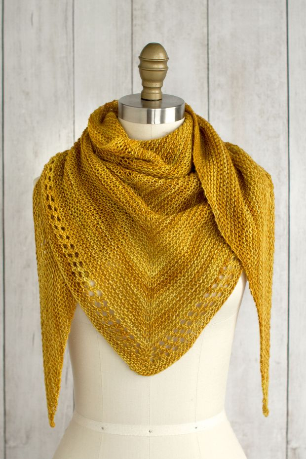 Just a day late… :-) (Photo: Fairmount Fibers Design Team) Ojete by the Fairmount Fibers Design Team is a beautifully simple and sunny summer shawl knit with just one skein of Manos del Urugu…