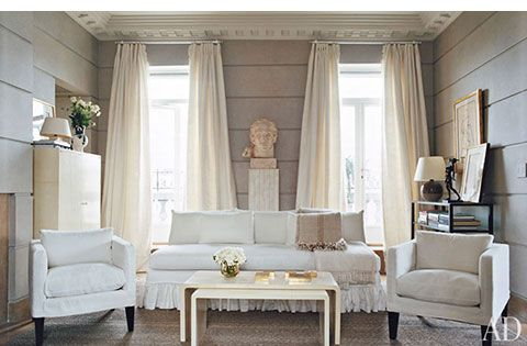 Pale gray wall treatment and white furnishings create a soft look.