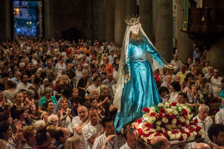 July 28, 2013. The statue of the 'Madonna della Fiumarola' (or Madonna del Carmine) is carried in procession inside the Basilica of Santa Maria Maggiore during the closing of the annual 'Festa de Noantri' in the Trastevere district in Rome.