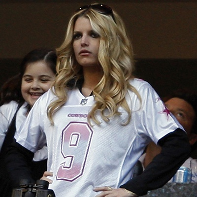 Actress Jessica Simpson watches a game between the Dallas Cowboys and the Philadelphia Eagles while wearing a Cowboys Tony Romo jersey. (Jessica Rinaldi/Reuters)
