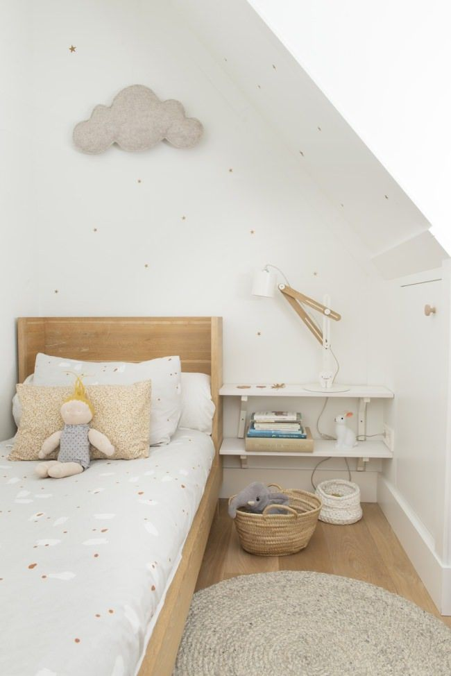 Natural tones kid's room; wall shelves for bedside storage