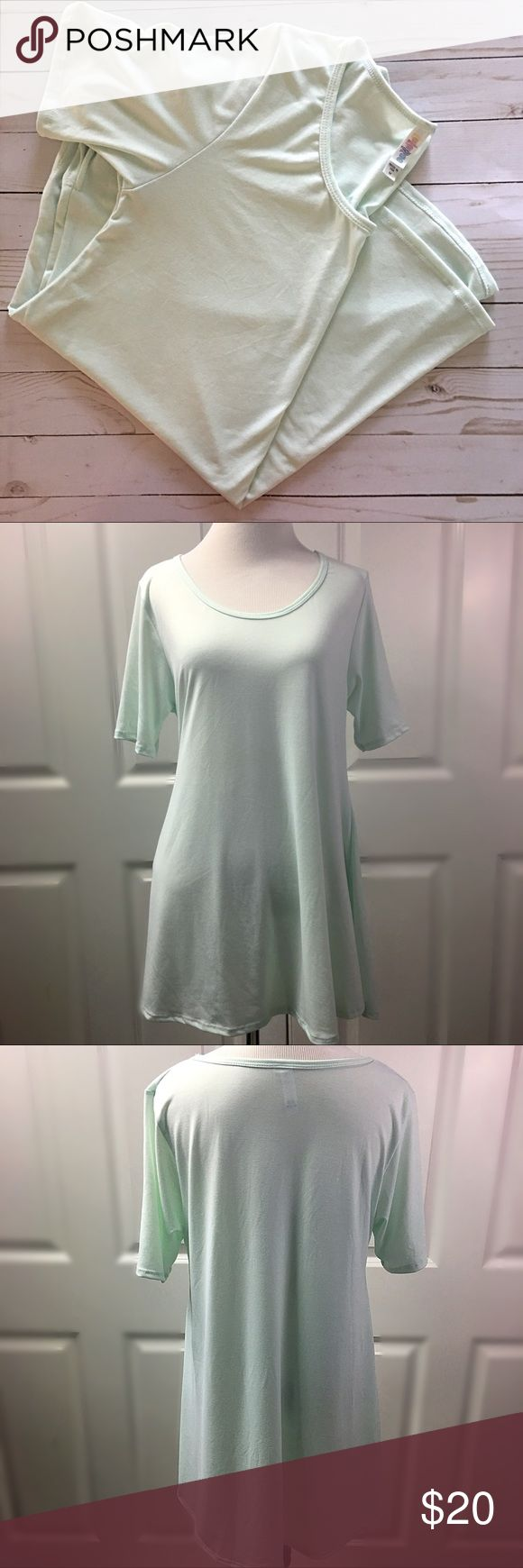 🆕! LuLaRoe Perfect T - Mint LuLaRoe Perfect T - Mint Shirt has been washed according to instructions but never worn.   LuLaRoe's Perfect T boasts a fun swing shape complimented by flirty side slits and a flattering half-sleeve that makes this simple, comfortable top the star of any outfit. Pair it with any of LuLaRoe's skirts and leggings for a look that can't be ignored!  No Trades. No offers accepted on this item. Price firm unless bundled. Thanks! LuLaRoe Tops