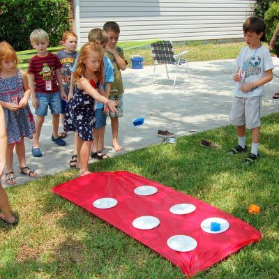 #LegoDuploParty - Lego Toss Game Idea - Super EASY! Great for getting a little movement in!  May have to make some lego shaped bean bags to go with it!-Carter's party?