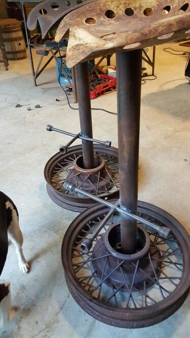 Barstools I made from Model A wheels, lug wrenches, and tractor seats.
