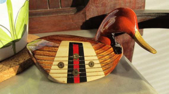 Old wooden golf clubs up-cycled and repurposed into wooden ducks that make a great gift for dad.