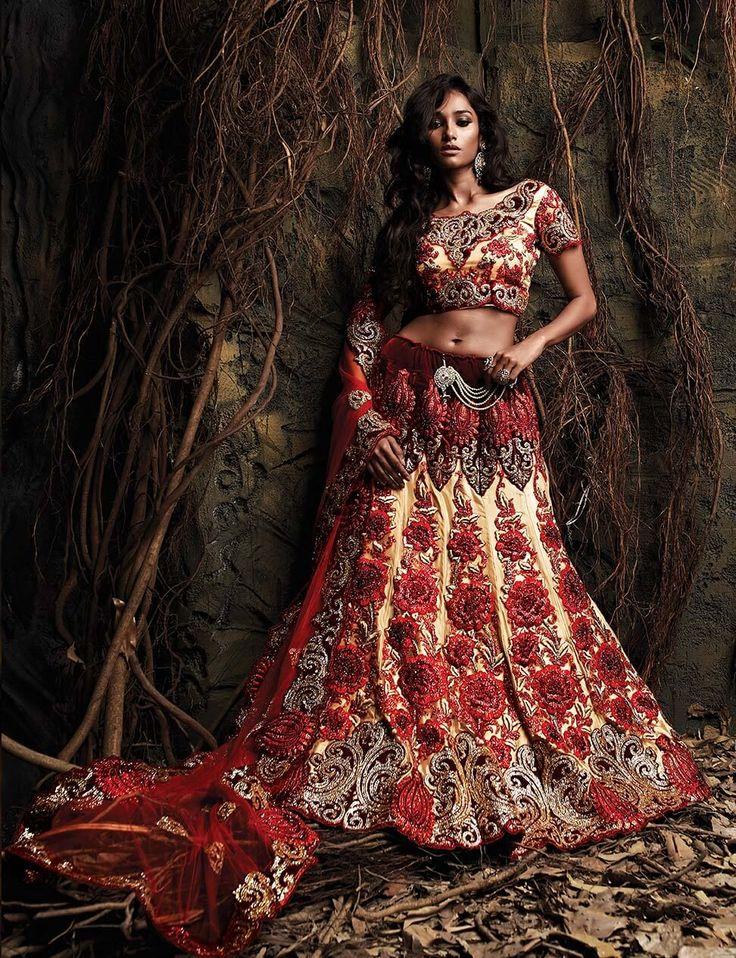 Red & chiku velvet and net designer lehenga for occasions like wedding, sangeet and reception.