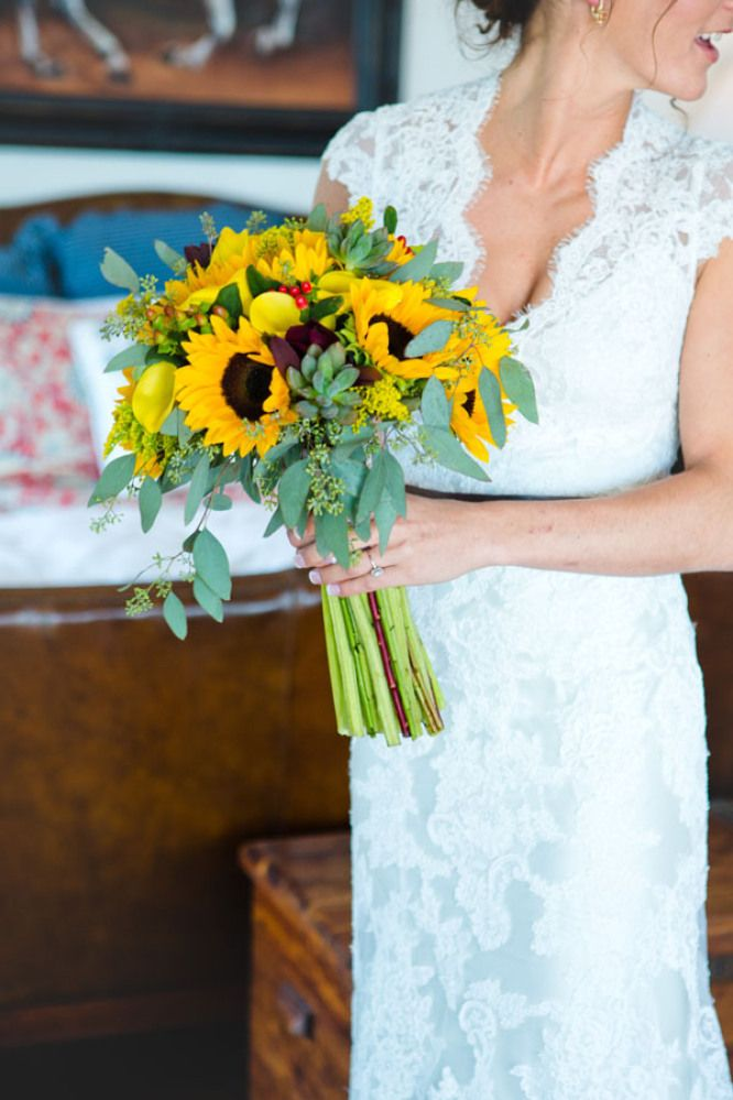 Brides bouquet of sunflowers, succulents and green foliage. St Simons Island wedding at the Villa de Suenos.