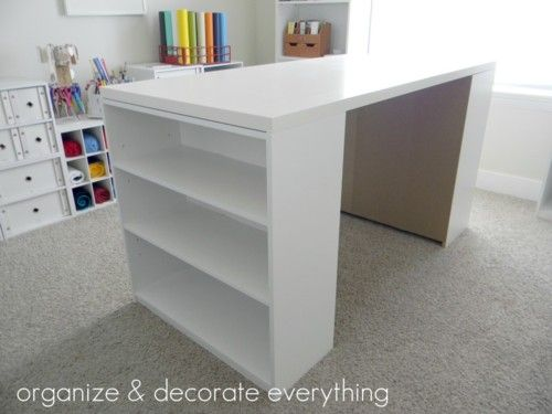 Easy way to make your own craft table - out of two bookcases and a top. Custom height and size, and easy to take apart and move (I know I love that part). And there you can stick those little bins in the bookcases to use for storage!