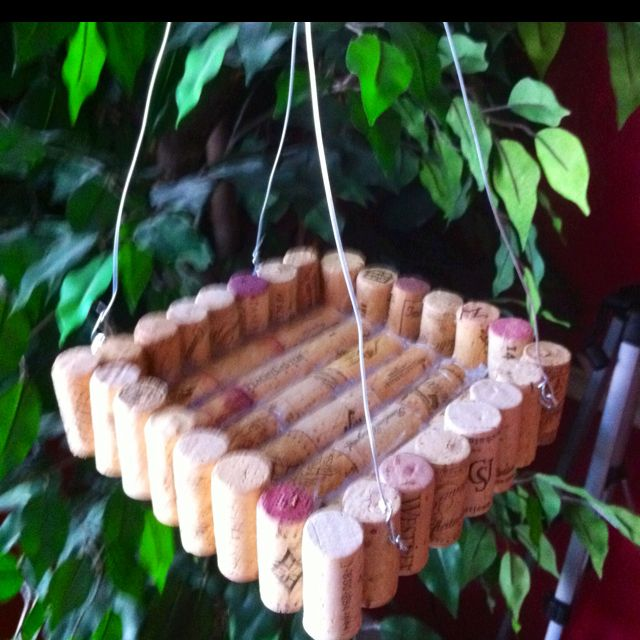 Hanging bird seed tray made with old corks- DIY