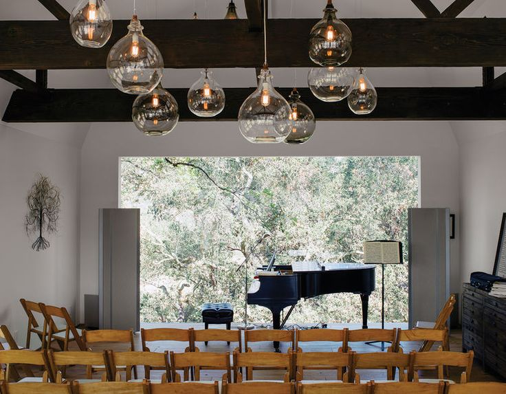 Located In The Renovated Barn Living Room Can Be Transformed Into A Performance Space That Seats Art Piece Is From South Africa
