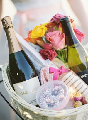 A chic and sophisticated way to officially kick off the wedding weekend is with a basket filled with food, wine and fun! Try adding a bouquet of fresh blooms for an added romantic touch