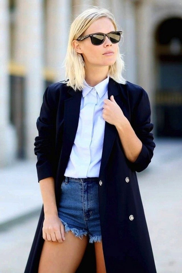 Jessie Bush // wayfarer sunglasses, blue button-down shirt, long coat and cutoff jean shorts