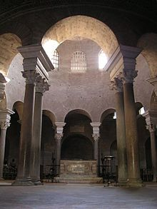 CENTRAL PLAN CHURCH: Santa Costanza, Rome. Rome. 337-351. The 4th-century mausoleum of St. Costanza is a round brick building with a small west porch. Inside, there is a simple altar under a central dome. The central area is surrounded by 12 pairs of Roman columns, which form a barrel-vaulted ambulatory around the outside. Originally, the walls were covered in marble.