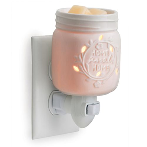 Candle Warmers brings us this Mason Jar Plug-In Fragrance Warmer. This decorative and versatile fragrance warmer can be used with any outlet vertical and horizontal by twisting the base. Ideal for abo