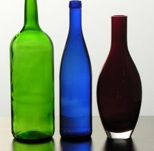 Flatten wine bottles in your oven...good for cheese cutting boards.