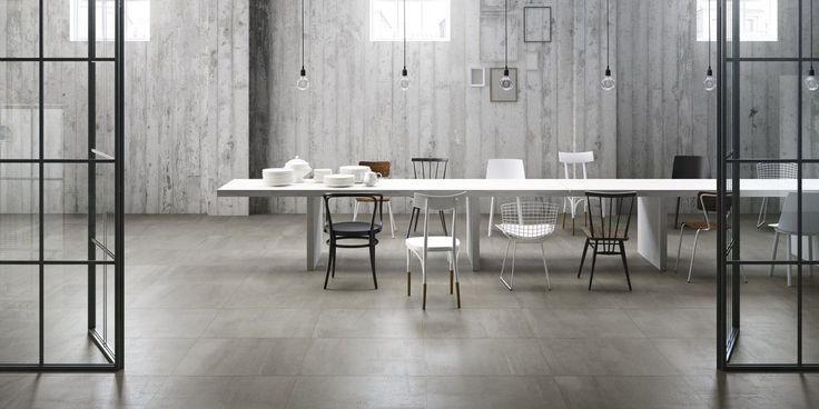 Concrete effect porcelain tiles in seven different shades of grey