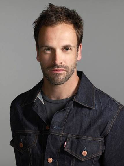 I watched about 15 minutes of Elementary over the weekend. I have no comment on the quality of the program, but I can appreciate the first time we meet Sherlock Holmes he is shirtless with an unshaven/unwaxed chest and sporting some quality tattoos.    Welcome back to television Jonny Lee Miller. I have missed you