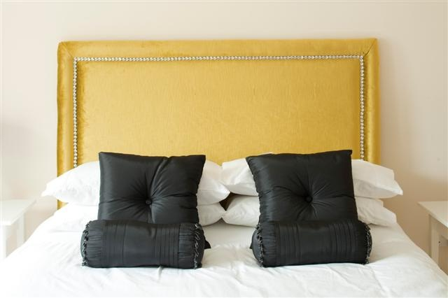 Fabulous headboard with crystal studding and raised border. Created by www.perfectheadboards.ie