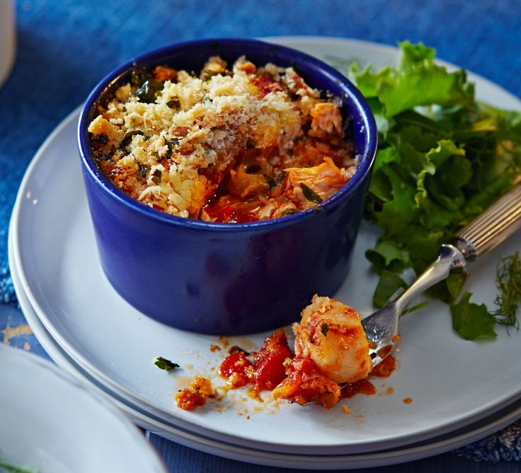 These individual portions of fish in tomato sauce, topped with herby breadcrumbs, freeze beautifully - perfect for no-fuss entertaining