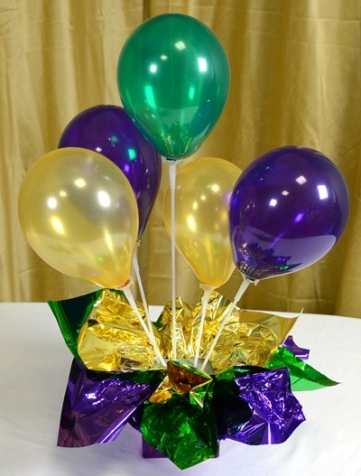 Air-filled Balloon Centerpieces: Ideas & Tutorials         Looking for the perfect centerpiece? Inexpensive and easy-to-make air filled balloon centerpieces are the answer! Air filled balloons make festive centerpieces with the added bonus that they can be created days in advance of an event. While standard helium balloons only last a few days, air filled balloons last for weeks. This type of balloon centerpieces is also well suited for outdoor events where helium balloons can get blown…