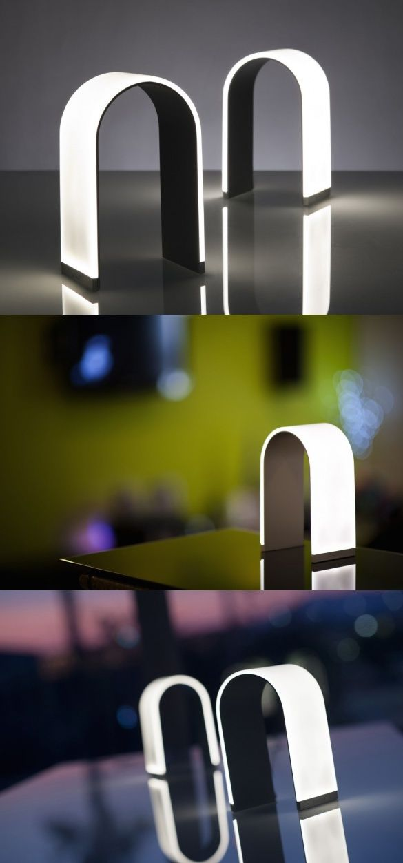 The Mr. N table lamp by Koncept Inc. is so minimal, it's amazing. At just 7mm thick and 190mm tall, this bent sheet of light is as calming as it's pretty. It comes in a simple design, no extra fluff, and thank heavens for no WiFi-enabled smartphone app nonsense. Touch the logo and Mr. N illuminates. Touch and hold to dim the lights. User interaction couldn't get any effortless. #Lighting #Lamp #Modern #Design #YankoDesign