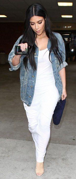Kim Kardashian keeps a low profile while strolling through LA airport