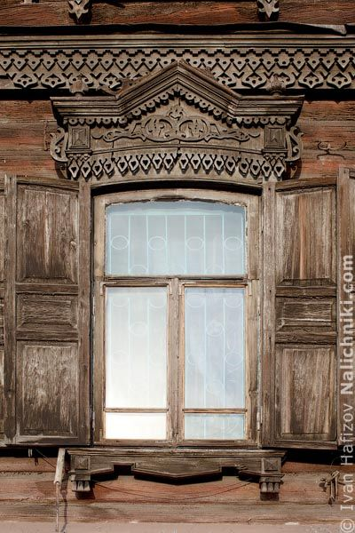 Wooden window frames with shutters. From Chita.