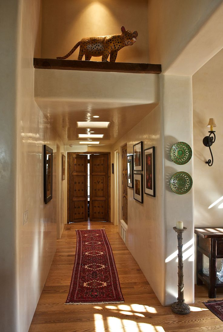 "Woods has clearly mastered Santa Fe's time honored architectural elements and beautiful proportions using indigenous materials, hand hewn vigas, deep set windows in thick plastered walls and cozy corner ""kiva"" fireplaces into our traditional homes."