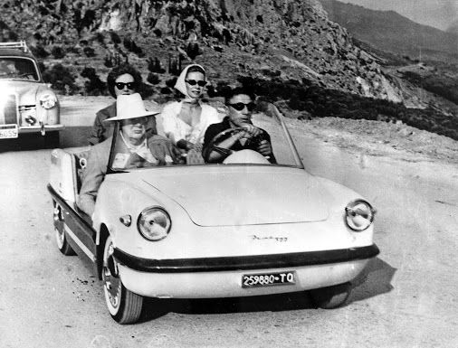 Sir Winston Churchill with Aristotle Onassis (driving) off to visit the famous Delphi antiquities in Central Greece ~ July 1959