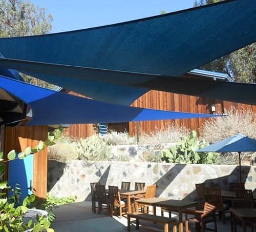 Overlapping shade sails can create interesting patterns and can maximize shade. For more ideas on designing a pergola or another cool spot in the shade, visit: http://www.landscapingnetwork.com/pergolas/#