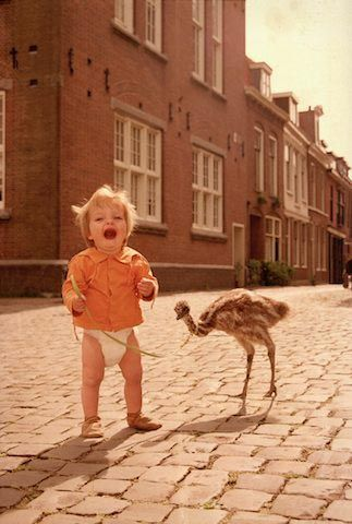 A girl and her baby ostrich :)
