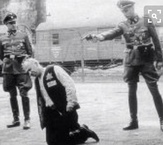 SS executes Jewish prisoner. All together it is estimated between 13.5 million and 15 million people died at the hands of the Nazis.