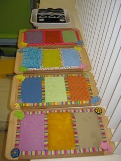 Sensory boards made out of dollar store cutting boards and common objects from the craft cupboard and around the house. There is sand paper - kitchen scrubbies - car wash mitts - place mats - terrycloth toweling - fun fur etc. The edging is made from colourful shoelaces and each item is glued down with tacky glue - I find it stronger than hot glue - it just had to dry for a couple of days before use.  The children really seem to enjoy them!