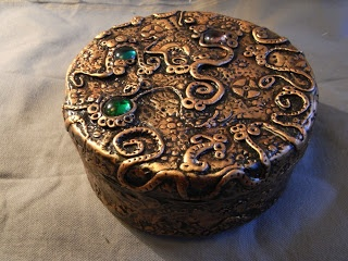Steampunk box - covered in polymer clay and stamped, painted etc. No tutorial but discussion of the process.