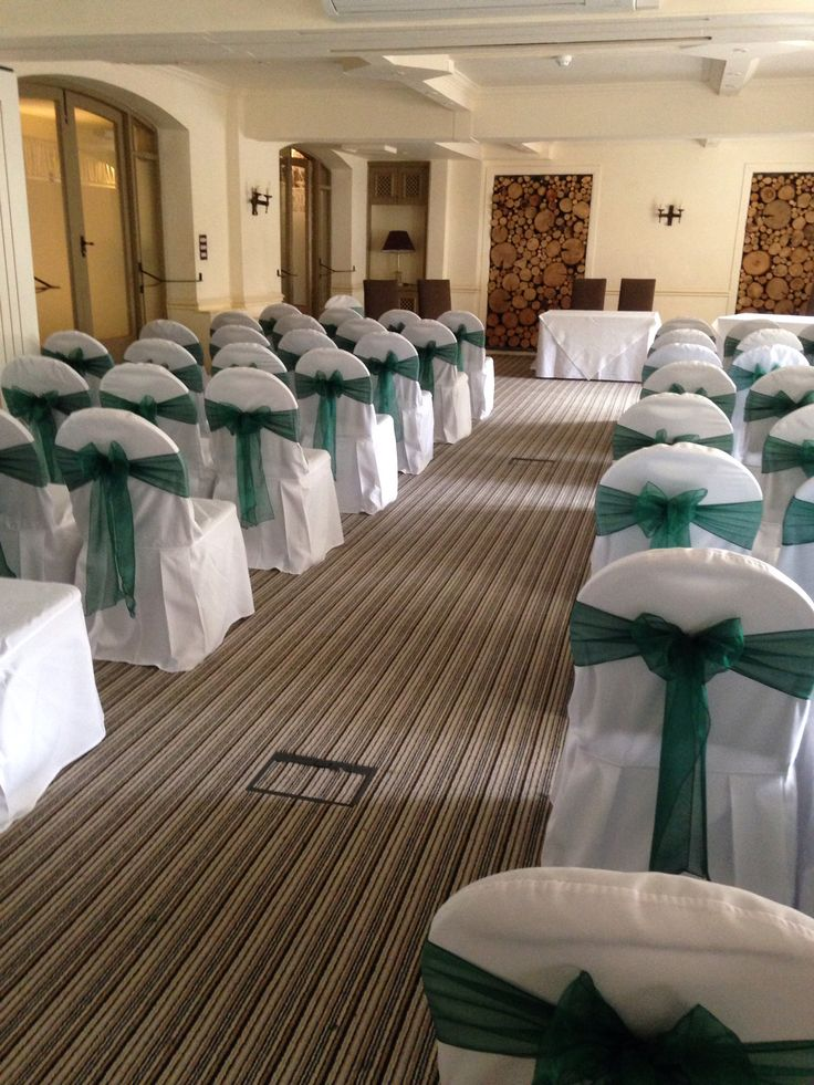 Chair covers with forest green sashes
