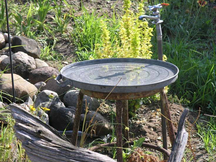 To Every Purpose: My mom's homemade bird bath: garbage can lid, milking stool, paired with old facet.