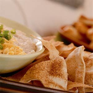 Pita rounds, garlic powder, and cooking spray are all you need for these homemade pita chips.  This recipe yields 4 dozen chips from only 6 pita rounds, so the cost is considerably less than purchasing them ready-made.This recipe goes with Opposing-Sides Two-Bean Dip