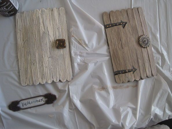 whimsical elf door, glue 8 popcicle sticks to paper, then glue in tabs.  Use moss & attach to bottom of larger potted plants...to make elf door