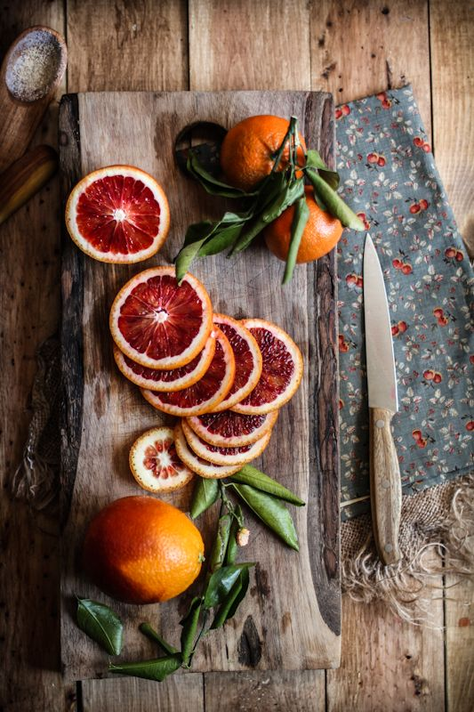 Good Photography- I love how raw and organic this picture is. By using butcher block and other shades of browns and grays really allow the blood red of the orange shine through. I also like how they placed the pieces of the orange almost like the swerve of a snake.,