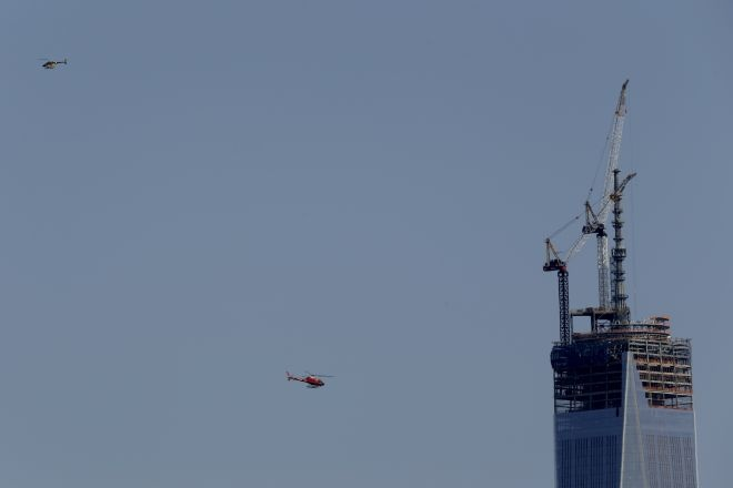 April 15, 2013: Helicopters fly near the construction site of One World Trade Center in Manhattan. Same day Two Bombs rip through the Boston Marathon . Source: AP