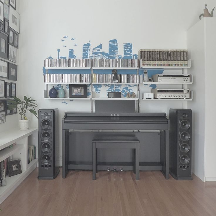 A Marantz stereo and a Clavinova piano tied together with a Vitsoe 606 universal shelving system