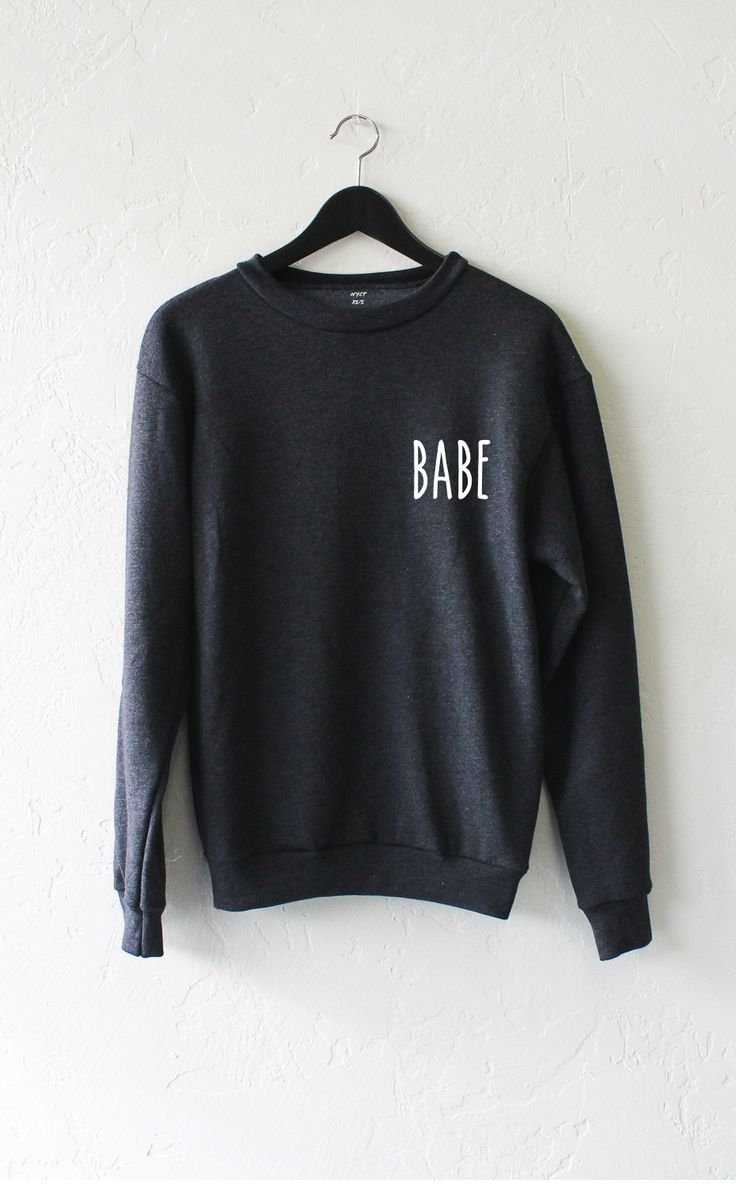 - Description - Size Guide Details: Get comfy in this super soft oversized crewneck fleece sweatshirt by NYCT Clothing topped with graphic 'Babe' on front left chest. 50% Cotton, 50% Polyester. Made i