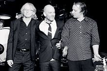 """R.E.M.-- was an American rock band from Athens, Georgia, formed in 1980 by lead singer Michael Stipe, lead guitarist Peter Buck, bassist/backing vocalist Mike Mills, and drummer Bill Berry. One of the first popular alternative rock bands, R.E.M. were noted for Buck's ringing, arpeggiated guitar style, Stipe's particular vocal quality, and Mills' melodic basslines and backing vocals. R.E.M. released their first single, """"Radio Free Europe"""", in 1981 on the independent record label Hib-Tone."""