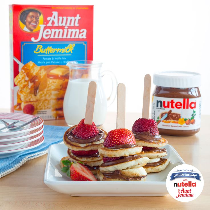 These Aunt Jemima® pancakes with Nutella® are stacked with flavor! Pile on the fun at your next family breakfast and set out some mini pancakes, fruit, Nutella® and popsicle sticks.