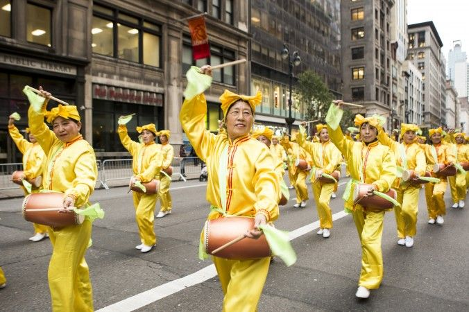 Falun Gong practitioners participate in the Veterans Day Parade in New York on Nov. 11, 2015. (Samira Bouaou/Epoch Times)