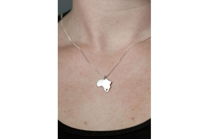 Africa Pendant with a tiny heart cut out in S.A by Natasha Wood Jewellery on hellopretty.co.za