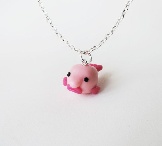 Meet Blobby the Blobfish! This little guy measures 1 inch from blobby nose to tail and comes on an 18 long chain necklace. Find more of Blobby the
